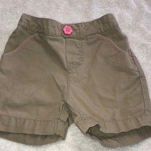 Tan Bermuda style shorts.